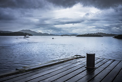 Over Loch Lomond (Neillwphoto) Tags: lochlomond luss pier jetty bollard lake water loch islands scotland boats stormy dark