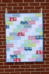 Baby Color Me Retro Braid Quilt (Jeni Baker) Tags: fall quilt market handmade sewing houston quilting 2012 quiltmarket artgalleryfabrics jenibaker colormeretro