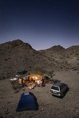 Camping under the stars (momentaryawe.com) Tags: camping wild camp sky mountains nature stars fire rocks uae middleeast rocky tent unitedarabemirates d800 hajar dibba catalinmarin momentaryawecom
