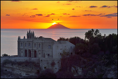 ...sun salutation... (zio paperino) Tags: travel trees sunset red sea sky italy mer seagulls holiday sol church nature birds yellow alberi clouds atardecer soleil mar nikon europa europe italia tramonto mare madonna coucher natura unesco chiesa sicily puesta obama calabria gabbiani