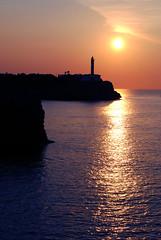 Portocolom (puzzlero) Tags: sol contraluz faro mar mediterraneo mallorca baleares portocolom puzzlero