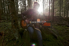 Marco (Kevin Cathers) Tags: trees musician music sun mountain man male nature forest canon vintage landscape switzerland moss woods guitar album zurich dude cover lensflare environment 5d sunrays gibson uetliberg markiii