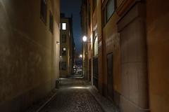 Walking down an empty alley (martin.sth) Tags: street night stockholm fujifilm gamlastan oldtown fujinon xpro1 fujifilmx fujifilmxpro1 18mmf20