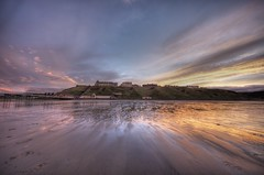 Saltburn at low tide - as the rain clears (velocettepaul) Tags: sunset beach rain pier pentax wideangle beech saltburn saltburnbythesea tonemapped pentaxk5