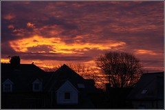 Burning sky (Capt' Gorgeous) Tags: red clouds sunrise roofs