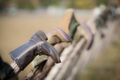 Boots on a Fence (Erik Pronske) Tags: fall fence boot texas boots cedar worn hillcountry hunt photoshopprocessedimages