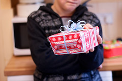 the boy and the christmas gift (slightly everything) Tags: christmas uk winter boy england holiday childhood wrapping one hands europe child wrapped gift giving bow present realpeople ©katehiscock