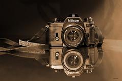 My First Camera! ~ EXPLORE (BGDL) Tags: sepia first explore gift nikonem firstcamera slrfilmcamera nikond7000 ourdailychallenge bgdl nikkor50mm118g 112picturesin2012 elementsorganizer11 50mm118eseries