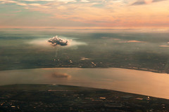 a cloud over industry (blueskyjunction photography) Tags: uk sunset chimney england sky cloud colour industry window nature beautiful beauty weather clouds liverpool buildings john river fly flying airport nikon industrial skies view natural dusk smoke horizon floating atmosphere aeroplane aerial smoking gb dslr float lennon mersey birdseye hovering 2012 hover d90 stunningskies