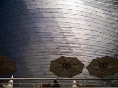 Umbrellas and Sunshine (pruse) Tags: light sun sunlight reflection sunshine metal architecture umbrella design spain shine gehry bilbao guggenheim shape
