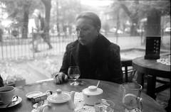 we are leaving you now (mannikon) Tags: bw film café monochrome zeiss flektogon 135 kraków cracow cracovia planty rynek exakta 2835 czj ihagee bunkier varexiia afterjby