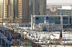 A Mosque and a Christmas Tree. East meets West in perfect harmony in Mahambet Square. (Far & Away (On assigment, mostly off)) Tags: christmas city winter snow west building contrast square asia europe peace muslim religion central mosque christmastree east tolerance harmony balance coexistence tradition centralasia festivities kazakhstan atyrau 100commentgroup