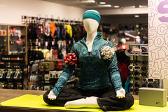 Meditation pose as crass window dressing. (Garen M.) Tags: yoga night zen shops ardmore commercialization citysports suburbansquare