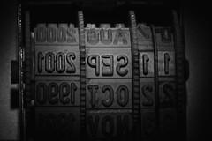 date (jumpandwave) Tags: somethingstartingwiththefirstletterofyourname macromondays macro closeup date stamp datestamp rubber cogs mono bw jumpandwave canon