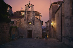 parting with Summer (cherryspicks (intermittently on/off)) Tags: wow korcula historic church dusk street town building architecture night lamp light person girl stonework bell croatia island travel summer catholic