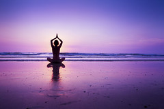 Woman practicing yoga on the beach (egizu) Tags: abstract active alone beach body breathe calm composure enlightenment equanimity exercise fitness freshness healthcare healthy life lifstyle listen lotus lotusposition meditation morning ocean one peace people perfection practice quiet reflection relax sea serenity silhouette sky solitude sport stillness stress training tranquility water woman yoga