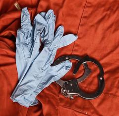 1016 of 1096 (Yr 3) - Random checks (Hi, I'm Tim Large) Tags: prison uniform orange overalls cuff cuffs handcuff handcuffs intimate inspection random checks checking personal gloves pvc rubber latex captive inmate prisoner