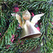 "This little angel (1.5"") is first on my Christmas tree.  She keeps in  memory my angel, Kyle, who died of a rare liver disease in 1962 at age 18 months.  Back then there were no liver transplants, but her little body aided research to discover what now can save many. Jeri Wright."