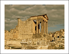 the roman city of dougga ..... (ana_lee_smith) Tags: africa city travel urban terrain history tourism archaeology stone museum architecture landscape temple photography site ancient arch village floor theatre roman tunisia plateau mosaic decorative stage capital north pillar masonry halls photojournalism unesco capitol national latin corinthian civilization column jupiter plains antonio minerva mythology pediment byzantine emperor juno colonnade settlement bardo polis excavation insitu fertile dougga pius dionysus epigraphy olivegroves publicbaths namidian analeesmith thougga sonyslta33 antonianbath licinianbath ouedkhalled douggaaljadida ulyssesthesirens nouvelledougga