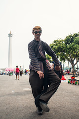 Monas Dancer (syukaery) Tags: street people man indonesia nikon dancer human jakarta 20mm busker monas nationalmonument javanese d700