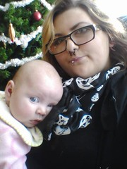 Me and my Goddaughter Samantha (M.Chmilowsky Photography) Tags: christmas baby white canada black tree cute green me scarf hair skulls glasses sweater december winnipeg blueeyes bib adorable christmastree piercing manitoba ornaments blonde samantha piercings goddaughter mb godmother wpg mandii mchmilowsky mcmilowskyphotography