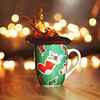 Merry Christmas (Sabine Fischer) Tags: christmas cup coffee dof bokeh newyear wishes splash merrychristmas 50mm14usm coffeesplash