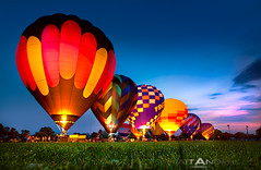 Hot Air Balloon Night Lights (Matt Anderson Photography) Tags: travel red color yellow blackbackground wisconsin night square outdoors photography fulllength large competition illuminated adventure transportation repetition monroe hotairballoon variation stationary inarow fourobjects colorimage traditionalfestival leisureactivity sportsrace recreationalpursuit otherkeywords incidentalpeople