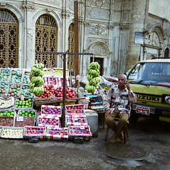 Cairo (Peter Gutierrez) Tags: africa street old city people urban streets building film public vegetables shop fruit buildings person town photo ancient traffic market pavement walk african markets egypt pedestrian business sidewalk peter cairo walker egyptian shops pedestrians gutierrez merchants walkers merchant businesses egyptians petergutierrez