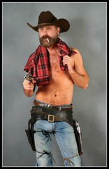 Shirtless an Bulging (Cowboy Tommy) Tags: shirtless hairy hot sexy fur beard model furry cowboy cigarette smoke blueeyes handsome belts balls wranglers dude smoking jeans western stache plaid levis stud buckles holster bulge treasuretrail gunbelt