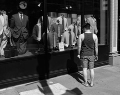 Casually-Dressed Man in Front of a Haberdashery, Portland Oregon (Blinking Charlie) Tags: street urban blackandwhite bw usa oregon portland blackwhite suits downtown mannequins flipflops tanktop shorts shopwindow haberdashery neckties 2012 swbroadway hatboxes johnhelmer casuallydressed blinkingcharlie fujifilmx10 traclighting