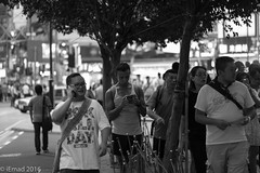 Life in Motion - HK (EHA73) Tags: aposummicronm1290asph leica leicamm typ246 hongkong streetphotography travel blackandwhite bw timessquare central crowd people