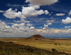 Ancient Volcano (studioferullo) Tags: volcano landscape air beauty big bluesky sky cloud clouds cloudy mountain hill bright colorful contrast white blue brown yellow green country old depth high historic world light nature natural outdoor outdoors outside park pretty scene serene trail skyline texture tone tones weather vulcan petroglyph nationalpark nationalmonument albuquerque newmexico field grassland