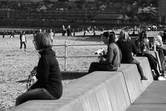 sunny day at Porty 01 (byronv2) Tags: edinburgh edimbourg scotland blackandwhite blackwhite bw monochrome candid street peoplewatching portobello beach sea rnbforth firthofforth forth river riverforth northsea autumn sunny coast coastal promenade seawall seat seated sitting