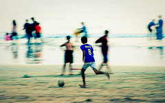 Kaka on the move ([s e l v i n]) Tags: india game football play action bombay pan kaka mumbai panning beachfootball versova boysplayingfootball versovabeach ©selvin indianfootball kakaplayingfootball lpfootball