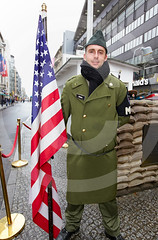 A US Soldier At Checkpoint Charlie Berlin Germany (Roger Cracknell Photography) Tags: travel people heritage history tourism danger soldier sad traditional victim political politics culture communism american berlinwall destination historical recreation tradition capitalism russian atmospheric touristattraction attraction coldwar ironcurtain belin capitalcity historoical