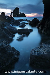 San Juan De Gaztelugatxe (Iigo Escalante) Tags: blue sunset sea sky espaa costa sun black sol water azul stone clouds de landscape atardecer coast mar spain agua san rocks cathedral juan negro silk catedral paisaje national shore cielo nubes reflejo planet conde lonely fotografia bizkaia seda vasco euskadi geographic vizcaya rocas pais norte nast piedras traveler cantabrico gaztelugatxe cantabric