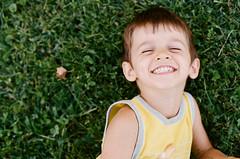 Kai (Cea tecea) Tags: boy green grass joy kai portra400 4years filmisnotdead