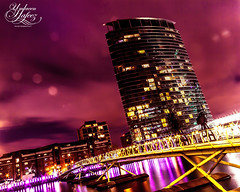 Docklands (Umbreen Hafeez) Tags: city bridge light color colour reflection building london thames architecture night buildings river dark hotel twilight cityscape bokeh east wharf docklands canary