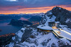 Pilatus station (Thierry Hennet) Tags: morning blue winter orange cloud house lake snow alps water rock zeiss sunrise landscape dawn hotel switzerland suisse sony landmark snowcapped pilatus ambient vierwaldstaettersee a900 highangleview cz2470mmf28