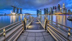 Storm Bay (Scintt) Tags: city bridge blue sky urban panorama storm reflection water lines rain skyline architecture modern night clouds marina buildings way lights evening bay pier hall twilight scenery singapore glow cityscape place skyscrapers stitch theatre dusk jetty centre towers images reservoir hour esplanade getty boardwalk cbd sands lead financial mbs raffles shenton scintillation scintt gettysingapore