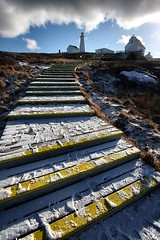 Follow the Yellow Wood Steps (Karen_Chappell) Tags: winter lighthouse snow canada clouds newfoundland steps nfld eastcoast capespear avalonpeninsula