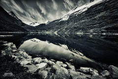Geiranger (bgspix) Tags: bw lake snow reflection nature norway rock landscape blackwhite fjord moutain geiranger sunnmre fjorden geirangerfjorden