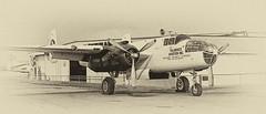 Antique B-25 N9451Z (eLaReF) Tags: county bw orange white black museum airplane paul aeroplane mitchell orangecounty warbird tallman sna b25 northamerican movieland mantz namerican ksna tallmantz