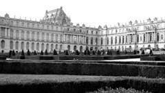 The Palace Faces Dusk (EmperorNorton47) Tags: versailles iledefrance france photo digital autumn fall outdoors palace hedges blackandwhite dusk cropped
