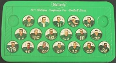 1964 Nalley's CFL Football Green Plastic Shield Holder / Wall Plaque Holder with 1964 Nalley's Saskatchewan Roughriders Football Coins (WhiteRockPier) Tags: 1964 nalleys football coins caps footballcoins footballcaps bclions britishcolumbialions edmontoneskimos calgarystampeders saskatchewanroughriders winnipegbluebombers blank back blankback cfl canadianfootballleague potatochips vintage plasticholders wallplaque plastiewallplaque greenplaque nalleysplasticcapholders envelope andymalycky spacemagicltd spacemagic westernconference profootballstars