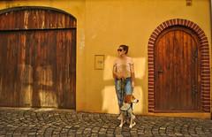 (SashaStepanov) Tags: dog europe street warm light yellow girl estonian hound doors