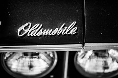 It's So Easy to Slip Out the Door (Thomas Hawk) Tags: california dreammachines dreammachines2010 halfmoonbay oldsmobile usa unitedstates unitedstatesofamerica auto automobile bw car emblem