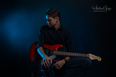 Lighting Practice (Andrea Garza ~) Tags: strobist flash lighting gel guitar fender stratocaster music moody mood lowlight dramatic newbraunfelsphotography texas tx newbraunfelsportrait newbraunfelsseniorpictures newbraunfelsseniorportraits newbraunfelsphotographer