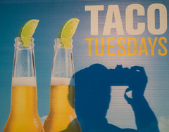 Taco Tuesday and Cold Coronas  :-) (Thru Mikes Viewfinder) Tags: shadow tacos beer corona olympusem1 sign poster sunrise morning