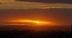 IMG_9867 In the ochre light of the setting sun. (Rodolfo Frino) Tags: settingsun sun yellowsun sunking light cloud ochre yellow orange building city landscape